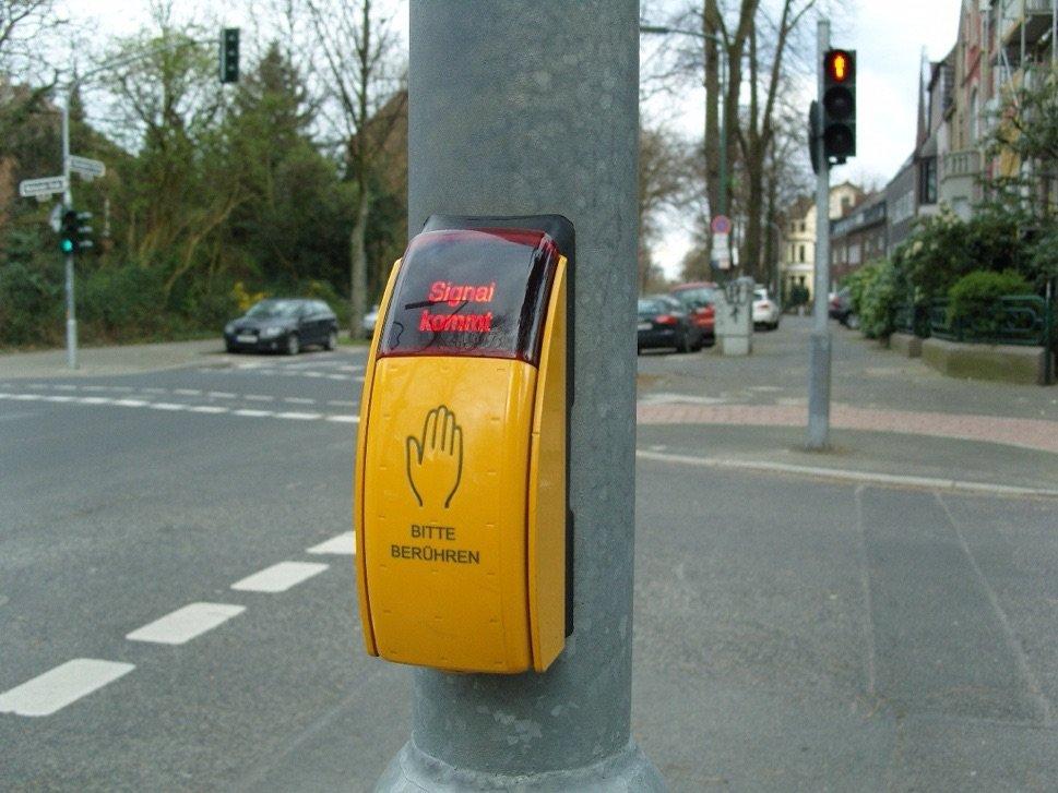 Pedestrian crossing call button