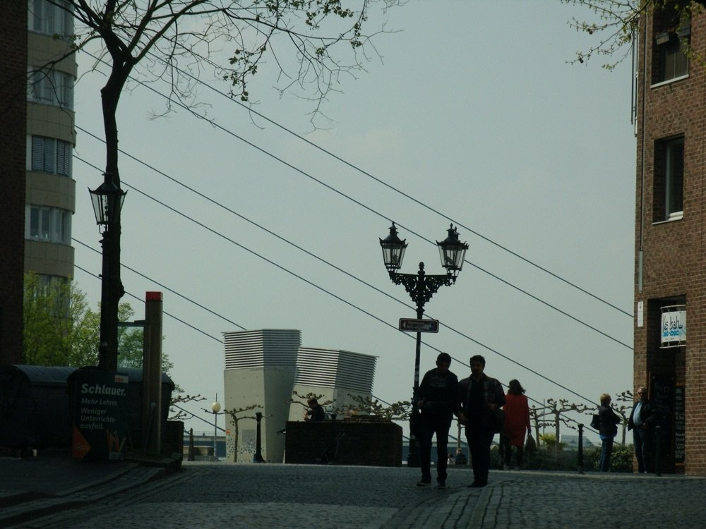 Street scene with lantern and people