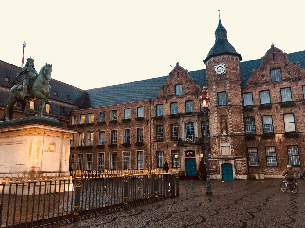 The old city hall in winter twilight