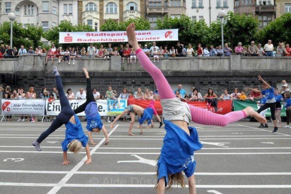 Children performing cartwheels