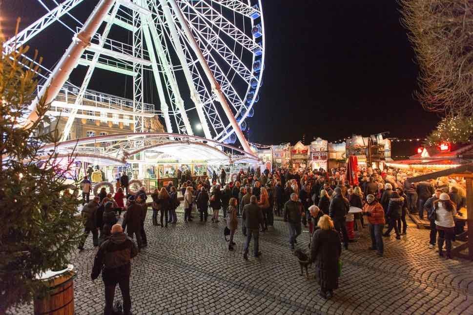 Ferris wheel with crowds