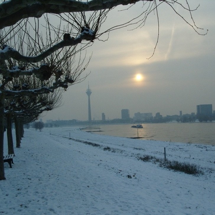 City horizon, river and snow covered banks
