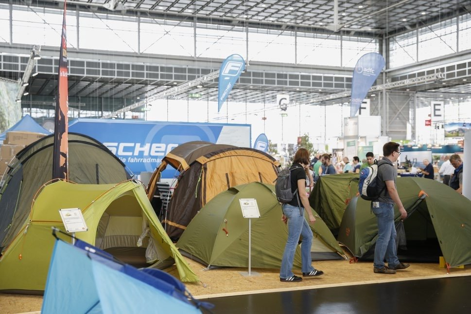 Multiple tents in trade fair hall