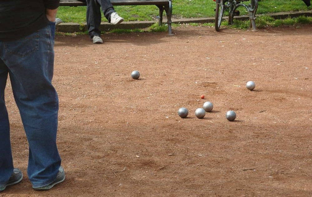 Boules balls on sandy play area