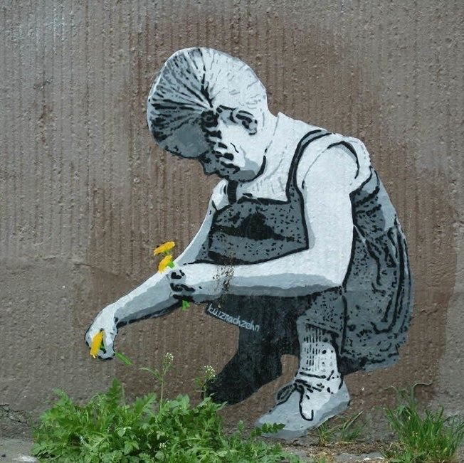 Street art of girl crouching