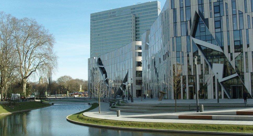Modern architecture beside brook