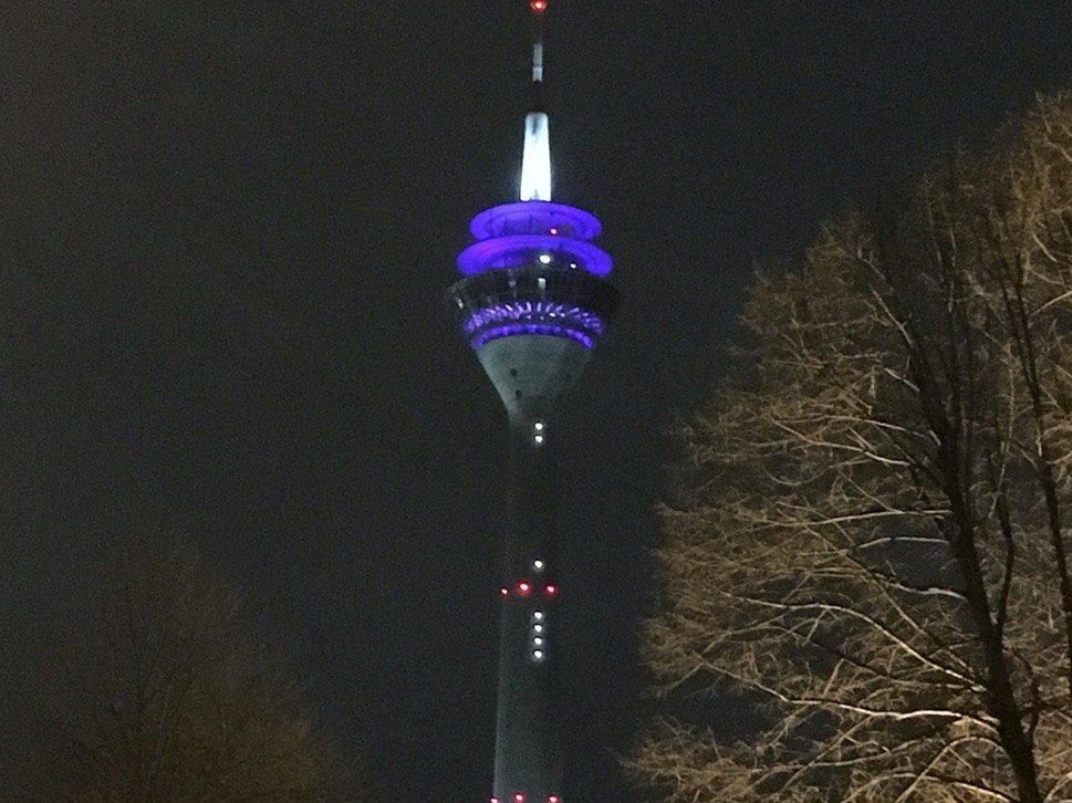 Tower with digital clock by night