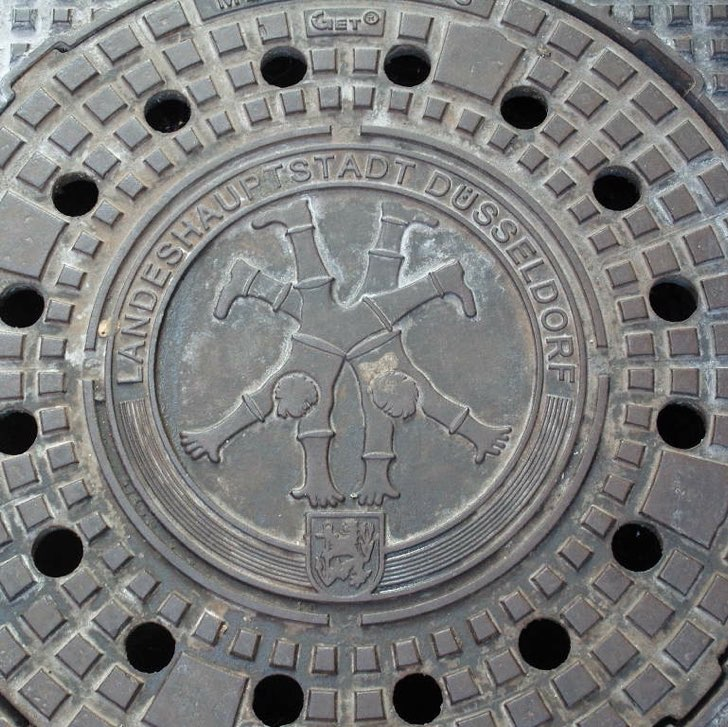 Drain cover with emblem