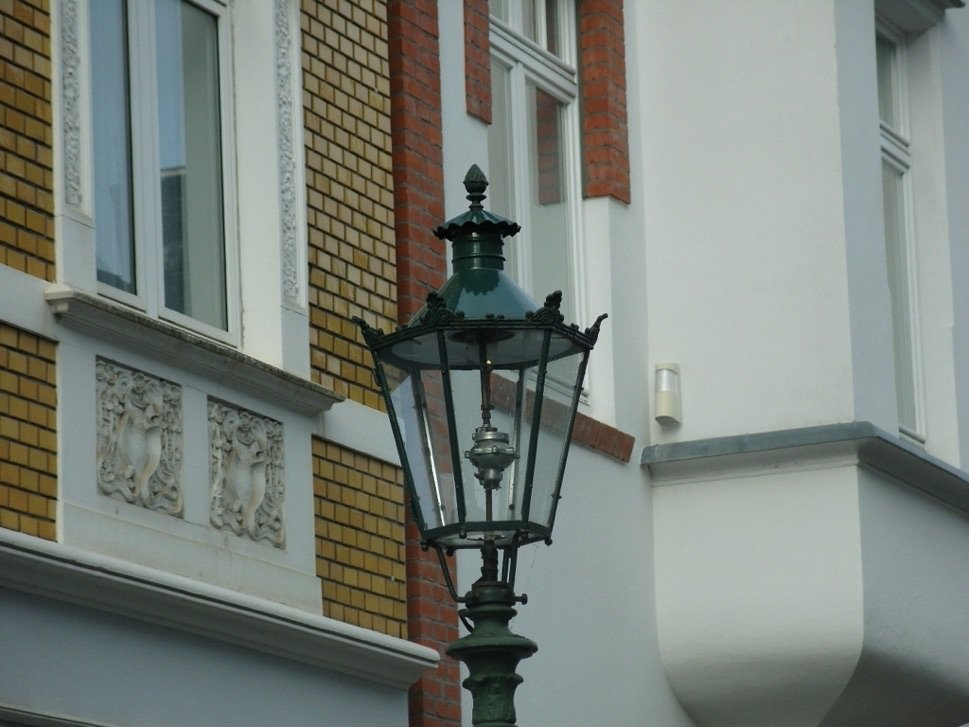 Gas lantern in front of building