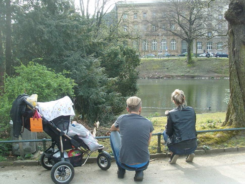 Couple with pram in park