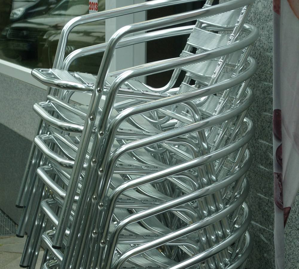 Stack of aluminium chairs