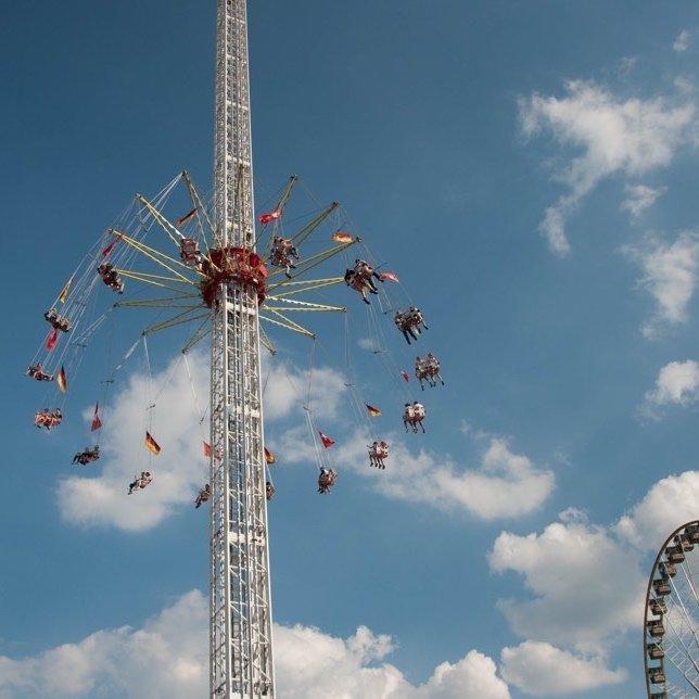 Funfair ride against blue sky