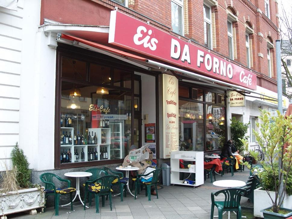 Ice cream store frontage with tables and chairs