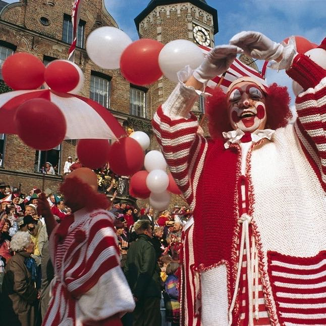 Clowns and balloons in carnival street festival