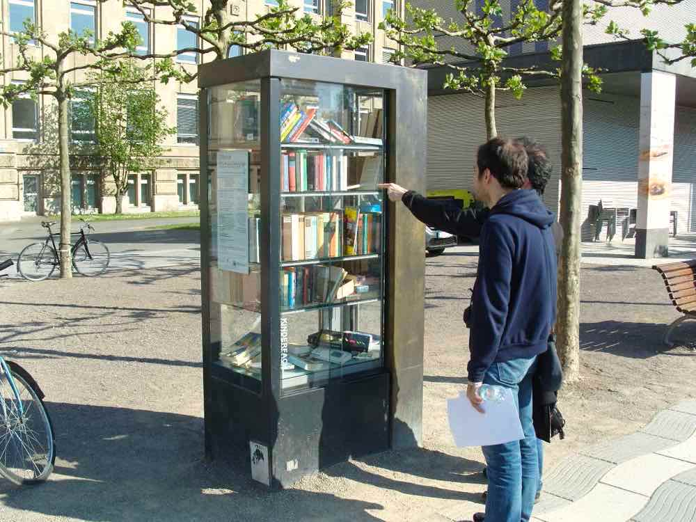 Books in glass cabinet outdoors